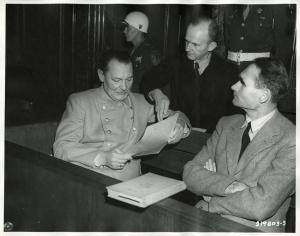 Defendants_Göring,_Dönitz,_and_Hess_conferring_Nuremberg_Trials